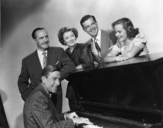 Fredric March, Myrna, Dana Andrews and Teresa Wright with Hoagy Carmichael at the piano