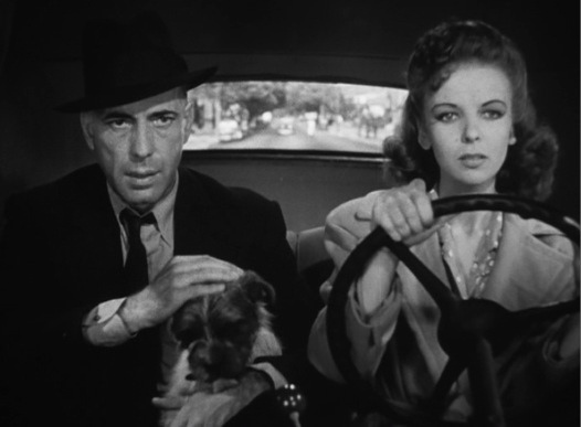 Aging criminal, Bogart as Roy 'Mad Dog' Earl and Ida Lupino as Marie, the woman who loves him