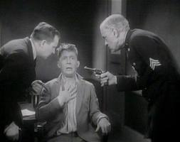 Chester Morris as Chick Williams explains he has an alibi