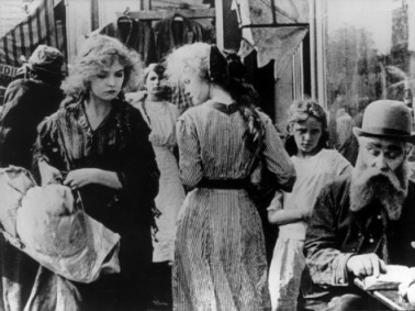 Lillian Gish as a young wife in the slums of Pig Alley