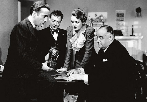 Bogart, Lorre, Astor and Greenstreet contemplate a falcon