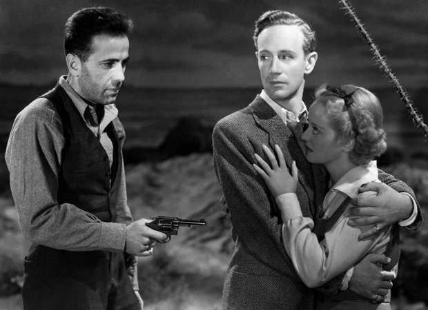 Humphrey Bogart as bank robber, Duke Mantee aims at Leslie Howard and Bette Davis