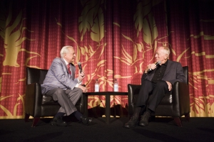 An engaged Osbourne talks to von Sydow before the screening of Three Days of the Condor