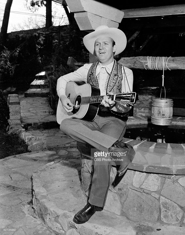 Gene Autry of the CBS radio program MELODY RANCH, at his home, posing 'candids'. January 1940. Copyright CBS Broadcasting Inc. All Rights Reserved. Credit: CBS Photo Archive. CBS code: 2744.