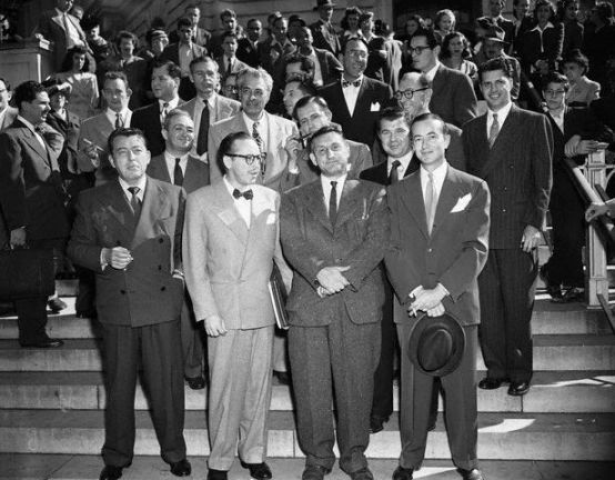 October 27, 1947, Washington, DC: The group of Hollywood writers and producers summoned to appear before HUAC photographed leaving the investigation. Front row: Lewis Milestone, Dalton Trumbo, John H. Lawson, who was cited for contempt, and Bartley Crum, attorney for witnesses. Center row: Gordon Kahn, Irving Pichel, Edward Dmytryk, Robert Rossen. Top row: Waldo Salt, Richard Collins, Howard Koch and Albert Maltz; Herbert Biberman; Lester Cole and Ring Lardner, Jr., writers and Martin Popper, another attorney for the group. Photo G.B. Kress, Corbis.