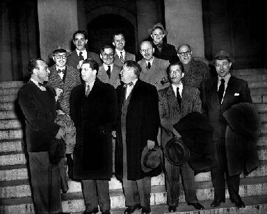 "The ""Hollywood 10"" stand with their attorneys outside district court in Washington, D.C., Jan. 9, 1948 before arraignment on contempt of Congress charges. The ten were charged for refusing to cooperate with the House Un-American Activities Committee. (AP Photo)"