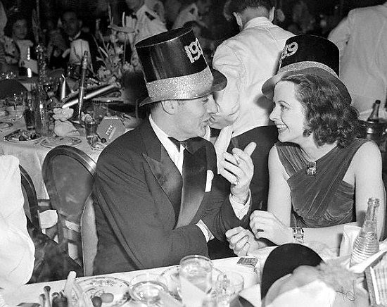 Charles Boyer and Hedy Lamarr enjoy New Year festivities
