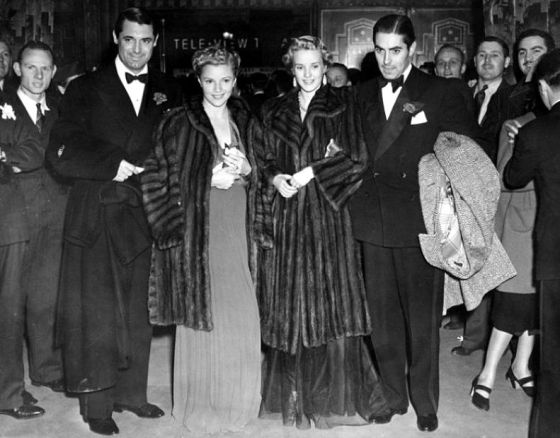 At The Pantages Theater for the Gunga Din premiere are Cary Grant, Annabella, Phyllis Brooks and Tyrone Power
