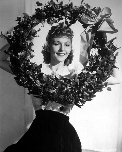 Relative Hollywood newcomer, Mary Martin in a studio-inspired pose wishing everyone the merriest of days
