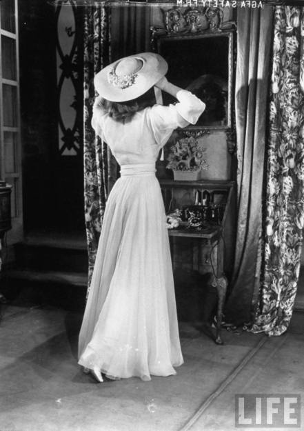 "Alfred Eisenstaedt: Actress Katharine Hepburn, adjusting her hat in mirror while in costume on set of her Broadway play ""The Philadelphia Story"""