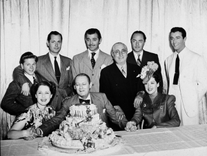 Mickey Rooney, Robert Montgomery, Clark Gable, William Powell, Robert Taylor, Norma Shearer, Lionel Barrymore & Rosalind Russell join Louis B. Mayer in celebrating Lionel Barrymore's 61st Birthday. April 28, 1939 - a Mayer favorite