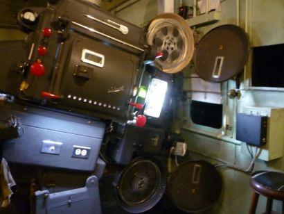 One of the Capitol Theatre's Simplex projectors with Carbon Arc lamp-house in action
