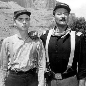 Jarman, Jr. and Wayne as father and son