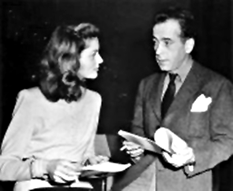 Bogie and Bacall discuss a script of BOLD VENTURE