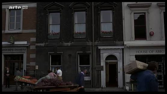 Londoners go about their business while a gruesome rape and murder takes place in this building