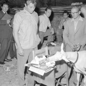 american-film-actor-robert-mitchum-watches-a-goat-eats-his-birthday-cake-at-his-41st-birthday-1958
