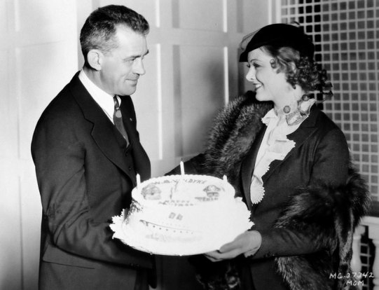 myrna-loy-presents-w-s-van-dyke-with-a-birthday-cake-on-the-set-of-manhattan-melodrama
