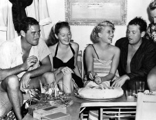 23rd November 1946, Film Stars (left to right) Errol Flynn with Mrs Nora Flynn, Rita Hayworth and her husband Orson Welles relax together on holiday in Acapulco, Mexico