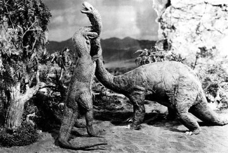 An Allosaurus bites a Brontosaurus