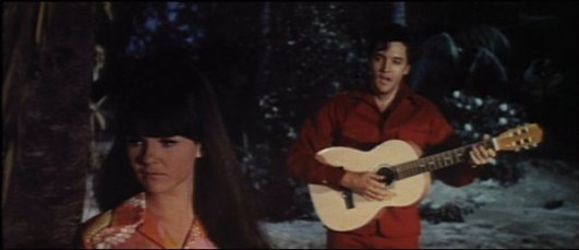 It may look like Elvis is singing to Shelley Fabares while strumming a simple guitar, but one chord and an entire band can be heard