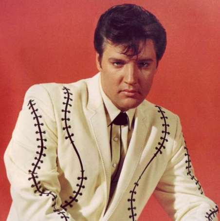 Elvis as Scott, the son of a rich oil tycoon