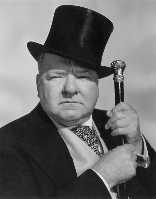 1940: Studio portrait of American actor and comedian W C Fields (1880 - 1946), aka Mahatma Kane Jeeves, aka Otis Criblecoblis, with top hat and cane. (Photo by Hulton Archive/Getty Images)