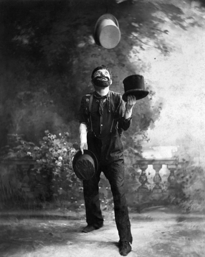 May 1900 --- W.C. Fields Juggling Top Hats --- Image by © Bettmann/CORBIS