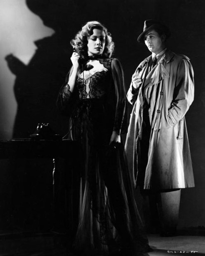 Greer as Moffat and Mitchum as Bailey in an Out of the Past publicity still