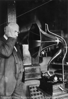 Thomas Edison listening to a phonograph. (Photo by Topical Press Agency/Getty Images)