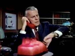 Commissioner Gordon on the Batphone