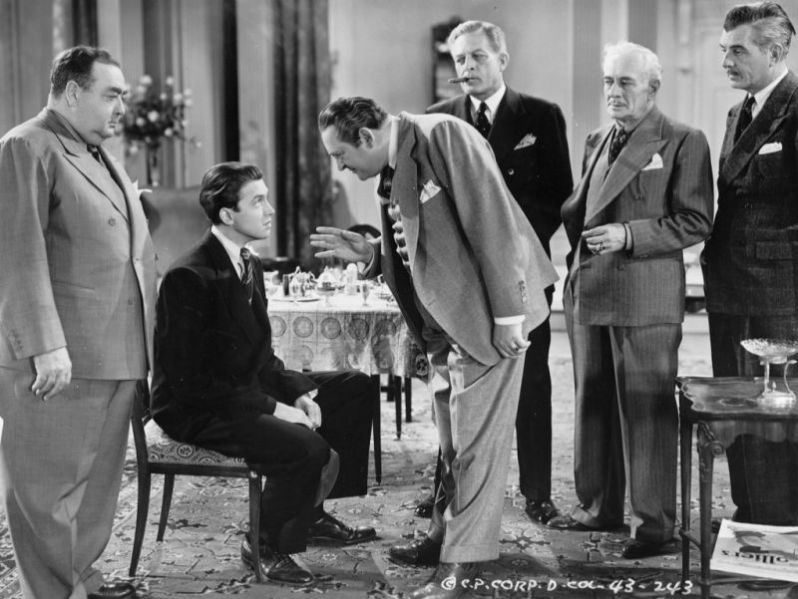 Pallette as Chic McCann stands by with James Stewart, H. B. Warner, Edward Arnold and Pierre Watkin in Mr. Smith