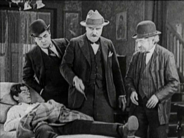 Pallette (standing left) as an insurance guy in the 1927 Hal Roach picture, Jewish Prudence.