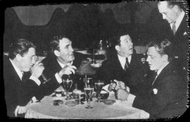 From left to right- Spencer Tracy, Pat O'Brien, Frank McHugh, James Cagney, and Lynne Overman (standing)
