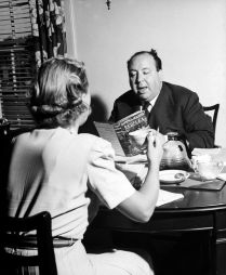 Alfred Hitchcock reading Daphne du Maurier's Rebbeca with screenwriter Joan Harrison