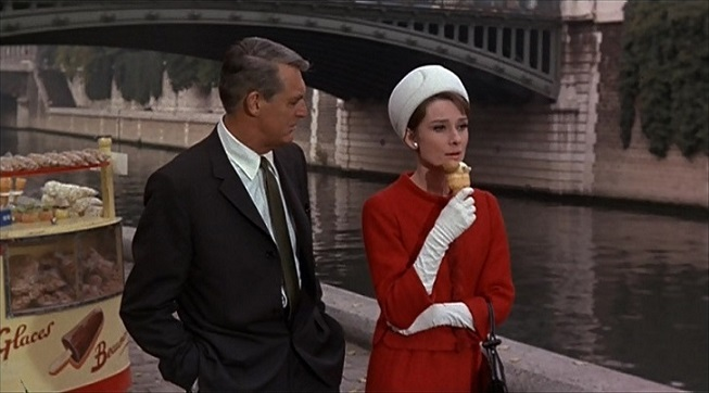 Near Pont au Double as Reggie and Peter discuss the difficult situation she finds herself in