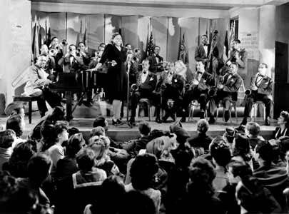 The Count Basie Orchestra accompanies Ethel Waters in the 1943 wartime film Stage Door Canteen.