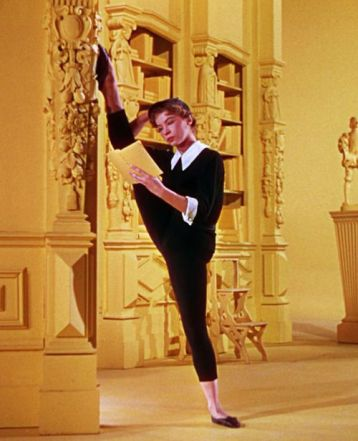 Leslie Caron reads and stretches during break on An American in Paris