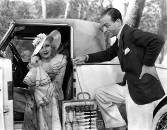 Astaire and Rogers pose in Ginger's Deusenberg for The Gay Divorcee