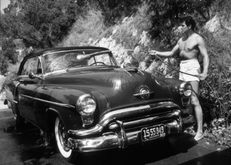 Rock Hudson washing his car