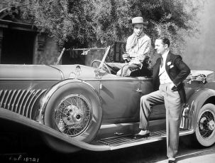 William Powell admires Gary Cooper's Deusenberg