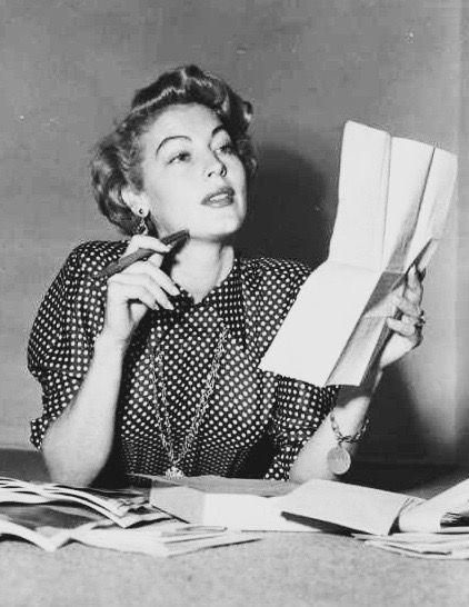 Ava Gardner reading her fan mail