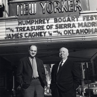 Alfred Hitchcock with Dan Talbot outside Talbot's New Yorker Theater, January 13, 1965.