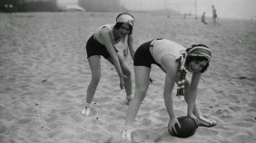 Joan Crawford playing on the beach with fellow star Dorothy Sebastian c. 1927