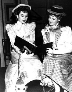 Olivia de Havilland and Rita Hayworth between scenes of %22The Strawberry Blonde%22