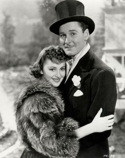 With Flynn in Four's a Crowd 1938