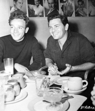 Dane Clark and John Garfield have lunch at the Warner Bros. commissary during filming of %22Destination Tokyo%22