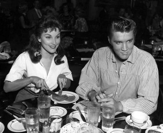 Debra Paget and Elvis enjoy lunch in the 20th Century Fox commissary