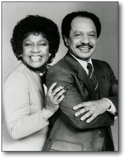 Sherman Hemsley as George Jefferson at odds with Carroll O'Connor as Archie Bunker