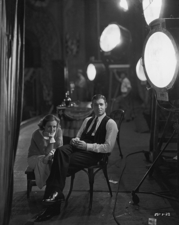 Crawford and Gable on set during the filming of POSSESSED