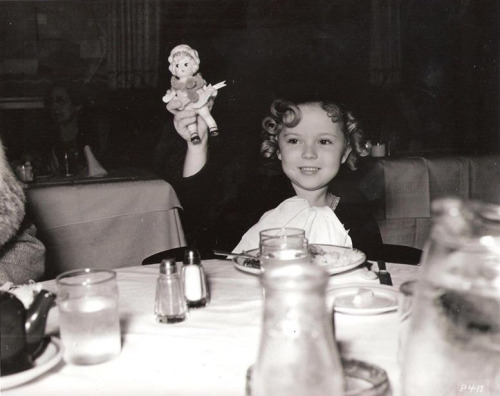 Shirley Temple eating at the studio commissary, 1934.